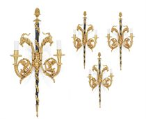 A SET OF FOUR FRENCH ORMOLU AND BLUED-STEEL TWIN-LIGHT WALL-APPLIQUES