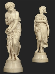 A PAIR OF FRENCH IVORY FEMALE