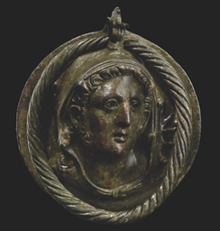 A HELLENISTIC BRONZE ROUNDEL