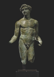 A ROMAN BRONZE MALE FIGURE