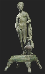 A ROMAN BRONZE FIGURE OF APHRO