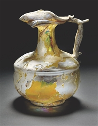 A ROMAN PALE YELLOW-GREEN GLAS