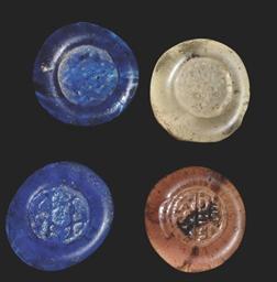 FOUR BYZANTINE GLASS TOKENS