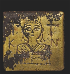 A BYZANTINE GILT BRONZE WEIGHT