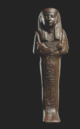 AN EGYPTIAN BRONZE SHABTI FOR