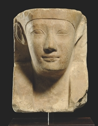 AN EGYPTIAN LIMESTONE SCULPTOR