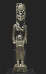 AN EGYPTIAN BRONZE FIGURE OF W