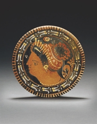 AN APULIAN RED-FIGURE PLATE, A