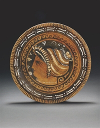 AN APULIAN RED-FIGURE PLATE