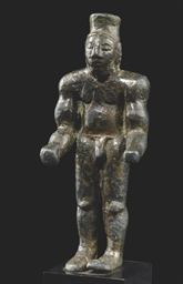 AN GREEK BRONZE MALE FIGURE