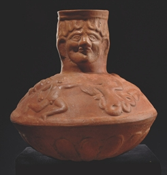 A ROMAN RED WARE POTTERY LAGYN