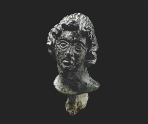 A GREEK BRONZE HEAD OF ALEXAND