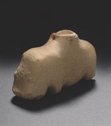 AN EGYPTIAN LIMESTONE HIPPOPOT