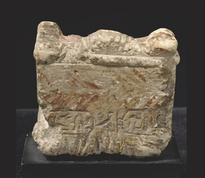 AN EGYPTIAN LIMESTONE VOTIVE A
