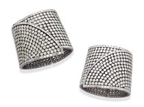 A PAIR OF IMPRESSIVE DIAMOND CUFF BRACELETS, BY TABBAH