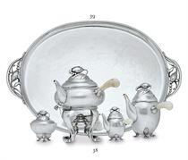 A DANISH SILVER FOUR-PIECE TEA AND COFFEE SERVICE DESIGNED B