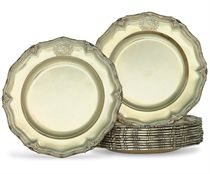A SET OF TWELVE REGENCY SILVER-GILT DINNER PLATES