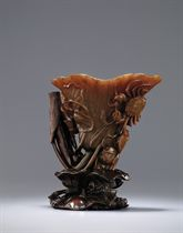 A RARE AND SUPBERLY CARVED LOTUS-LEAF SHAPED RHINOCEROS HORN