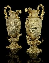 AN IMPORTANT AND MASSIVE PAIR OF GEORGE IV SILVER-GILT EWERS