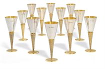 A SET OF TWELVE ELIZABETH II PARCEL-GILT SILVER GOBLETS