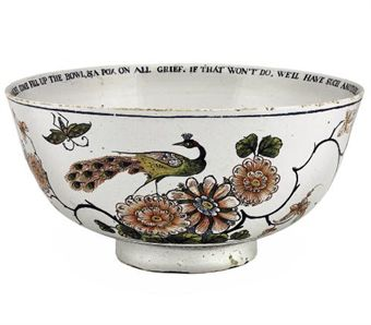 AN ENGLISH DELFT INSCRIBED AND DATED PUNCH-BOWL