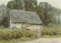 A young girl outside a cottage in Hagbourne, Berkshire
