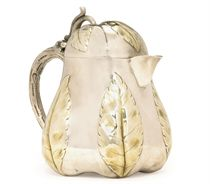 A RUSSIAN PARCEL-GILT SILVER JUG IN JAPANESE STYLE