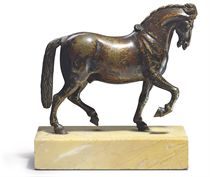 A BRONZE MODEL OF A PACING HORSE