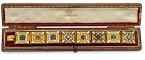 AN ARCHAEOLOGICAL REVIVAL GOLD, ENAMEL AND GEM-SET BRACELET, BY CARLO GIULIANO