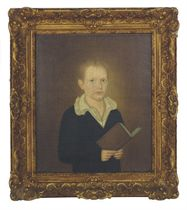 Portrait of a boy holding a book