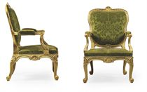A PAIR OF GEORGE II GILTWOOD OPEN ARMCHAIRS