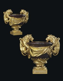 A PAIR OF LOUIS XV ORMOLU AND PORPHYRY VASES