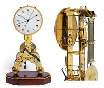 A LOUIS XVI BRASS AND ROUGE GRIOTTE MARBLE SKELETONISED MANTEL REGULATOR WITH REMONTOIRE AND CALENDAR