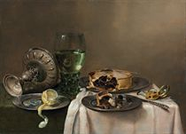 A 'pronk' still-life, with a roemer, an upturned silver tazza, a half-peeled lemon on a pewter plate, with a pie, a timepiece and a knife