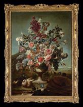 Tulips, roses, peonies, irises and other flower in an ornamental urn, with a pair of doves