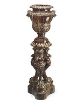 A FRENCH MOTTLED-BROWN EARTHENWARE JARDINERE AND PEDESTAL,