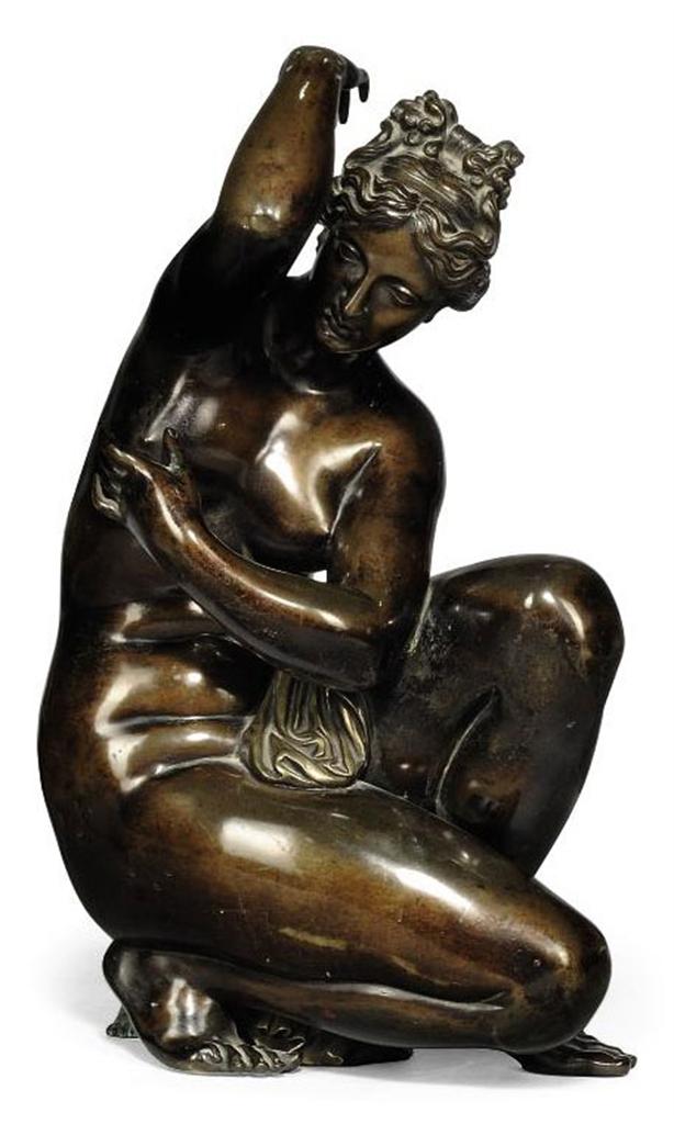 An Italian Bronze Figure Of The Crouching Venus Of