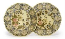 A PAIR OF ZSOLNAY POTTERY PIERCED DISHES