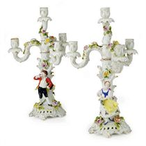 A PAIR OF GERMAN FLOWER ENCRUSTED PORCELAIN FIGURAL FIVE-LIGHT CANDELABRA DEPICTING A GALLANT AND COMPANION,