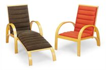 A SET OF THREE ASH AND UPHOLSTERED RECLINING LOW ARMCHAIRS,