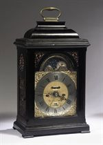 A DUTCH EBONIZED STRIKING TABLE CLOCK WITH ALARM AND MOONPHASE