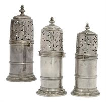 A MATCHED SET OF THREE WILLIAM III GRADUATED SILVER LIGHTHOUSE CASTERS