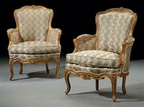 A PAIR OF LOUIS XV GILTWOOD BERGERES