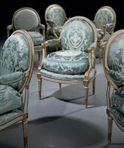 A SET OF SIX LOUIS XVI WHITE-PAINTED AND PARCEL-GILT FAUTEUILS