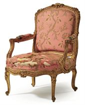 A LATE LOUIS XV GILTWOOD FAUTEUIL