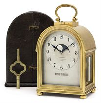 A FRENCH GIANT GILT-BRASS GRANDE SONNERIE CARRIAGE CLOCK WITH PERPETUAL CALENDAR, MOON PHASE AND ALARM
