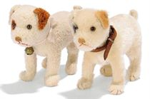 TWO STEIFF STANDING YOUNG FOX TERRIERS, one white wool plush