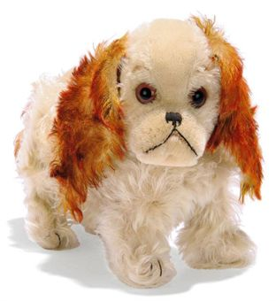 A STEIFF STANDING MUSICAL CHARLY, (1322,03), white mohair, brown tipped mohair tail and ears, brown and black glass eyes, black stitching, swivel head, pressure-operated musical mechanism and FF button with remains of red cloth tag, circa 1929 --10¾in. (27.5cm.) long (slight thining)