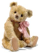 A STEIFF LARGE-EYED BROWN-TIPPED GOLDEN TEDDY BEAR, jointed, mohair, large brown and black glass eyes, brown stitching, inoperative growler and FF button, 1920s --17in. (43cm.) high (some slight fading and thinning)