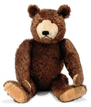 A STEIFF LARGE BROWN DICKY TEDDY BEAR, (5375), jointed, mohair, brown and black glass eyes, inset short blonde mohair muzzle, black stitching, printed velvet pads, inoperative squeaker and FF button, circa 1930s --29in. (73.5cm.) high (some general wear, thining and fading)